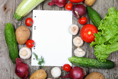 Fresh vegetables and a paper for recipe Stock Images