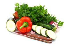 Fresh vegetables, parsley and knife. Stock Photos