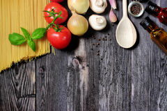 Fresh vegetables and pasta on dark wood Royalty Free Stock Photography