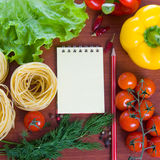 Fresh vegetables,pasta and a notebook Stock Photos