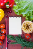 Fresh vegetables,pasta and a notebook Royalty Free Stock Image