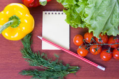 Fresh vegetables,pasta and a notebook Stock Image