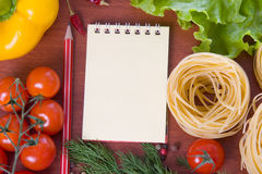 Fresh vegetables,pasta and a notebook Royalty Free Stock Photo