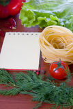 Fresh vegetables,pasta and a notebook Royalty Free Stock Photography