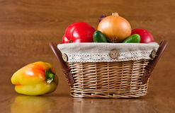 Fresh vegetables, peppers, tomatoes in basket Royalty Free Stock Image