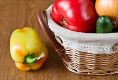 Fresh vegetables, peppers, tomatoes in basket Stock Photography