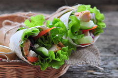 Fresh vegetables in pita bread, with the boiled chicken, olives and Feta cheese Royalty Free Stock Photo