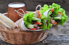 Fresh vegetables in pita bread, with the boiled chicken, olives and Feta cheese Stock Photo