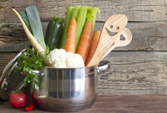 Fresh vegetables in the pot on vintage boards Stock Photography