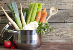 Fresh vegetables in the pot on vintage boards Royalty Free Stock Photography