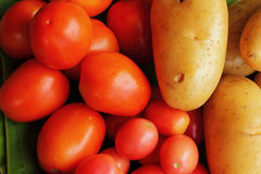 Fresh vegetables - potatoes, tomatoes. Royalty Free Stock Photography