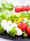 Fresh vegetables and quail eggs. Closeup Stock Photography