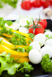Fresh vegetables and quail eggs. Closeup Royalty Free Stock Photo