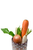 Fresh vegetables Raw Carrot,onion,radish in basket isolated on w Stock Photography