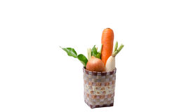 Fresh vegetables Raw Carrot,onion,radish in basket isolated on w Stock Images