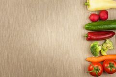 Fresh vegetables raw diet. Preparing vegetarian food. Vegetable menu. Fresh organic vegetables on the table. Diet meals. Stock Image