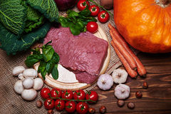 Fresh vegetables and raw meat on a sacking Stock Photos