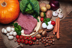 Fresh vegetables and raw meat on a sacking Royalty Free Stock Image