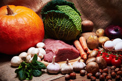 Fresh vegetables and raw meat on a sacking Royalty Free Stock Photography