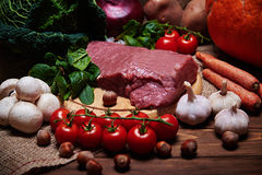 Fresh vegetables and raw meat on a sacking Royalty Free Stock Images