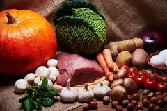 Fresh vegetables and raw meat on a sacking Stock Image