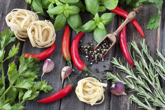 Fresh vegetables with raw pasta Stock Photos