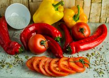 Fresh vegetables ready for a tasty salad. On a marble table Royalty Free Stock Images