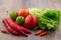 Fresh vegetables: red chilli, birds eye chilli, lettuce, red tomato and green tomato Royalty Free Stock Photography