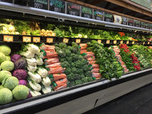 Fresh vegetables in refrigerator selling Stock Photos