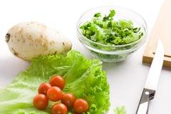 Fresh vegetables for salad. Over white background stock photos