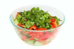 Fresh vegetables salad. Bowl with fresh salad isolated on white Stock Image