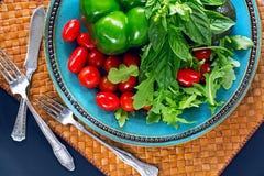 Fresh vegetables, salad arugula, basil, cherry tomatoes, paprika Royalty Free Stock Image