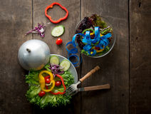 Fresh vegetables salad on bowl with measuring tape over wooden b Stock Images