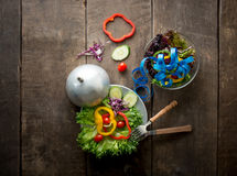 Fresh vegetables salad on bowl with measuring tape over wooden b Royalty Free Stock Photography