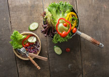 Fresh vegetables salad on  bowl with measuring tape over wooden Royalty Free Stock Photos