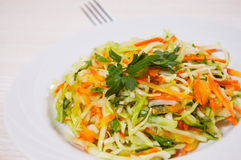 Fresh vegetables salad with cabbage and carrot. On white plate Royalty Free Stock Photography