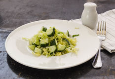 Fresh vegetables salad with cabbage and cucumber. Fresh vegetables salad with cabbage and frech cucumber Stock Image