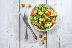 Fresh vegetables salad with croutons and chicken Stock Photo