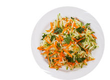 Fresh vegetables salad with cucumber and carrot. top view. isolated. On white Royalty Free Stock Image