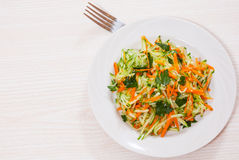Fresh vegetables salad with cucumber and carrot. On white plate Royalty Free Stock Photography