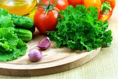 Fresh vegetables for the salad on a cutting board Royalty Free Stock Photo
