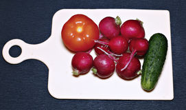 Fresh vegetables for salad on a cutting board Royalty Free Stock Photos