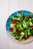 Fresh vegetables salad with greens and tomatoes Stock Images