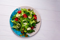 Fresh vegetables salad with greens and tomatoes Royalty Free Stock Image
