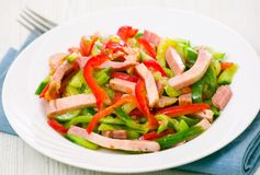 Fresh vegetables salad with ham. On plate Stock Images