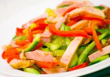 Fresh vegetables salad with ham. On plate Stock Photos