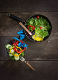Fresh vegetables salad on the pan and bowl with measuring tape o Royalty Free Stock Photo
