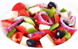 Fresh vegetables salad. Fresh vegetables salad on plate, isolated on a white background Stock Image