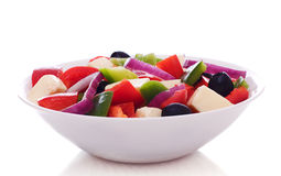 Fresh vegetables salad. Fresh vegetables salad on plate,  on a white background Royalty Free Stock Photography