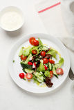 Fresh vegetables salad on white plate. Food top view Stock Photos